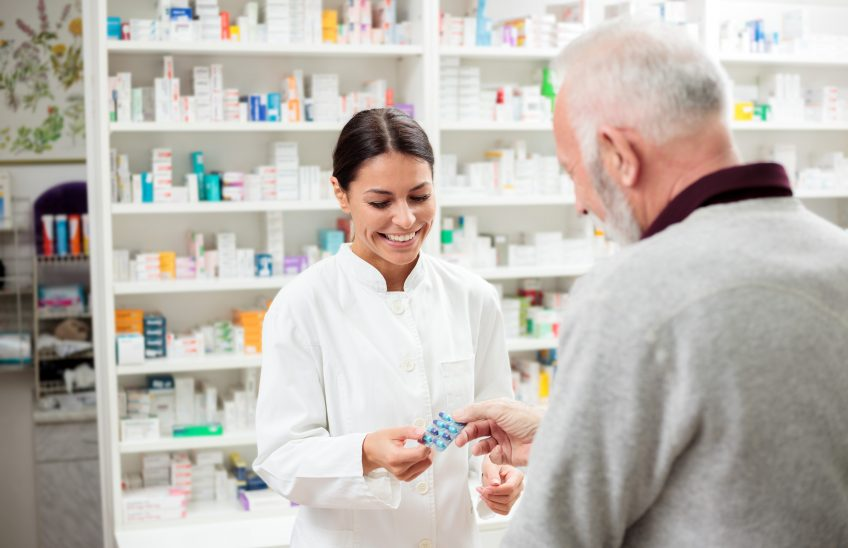 Pharmacist Helping Man with Medication